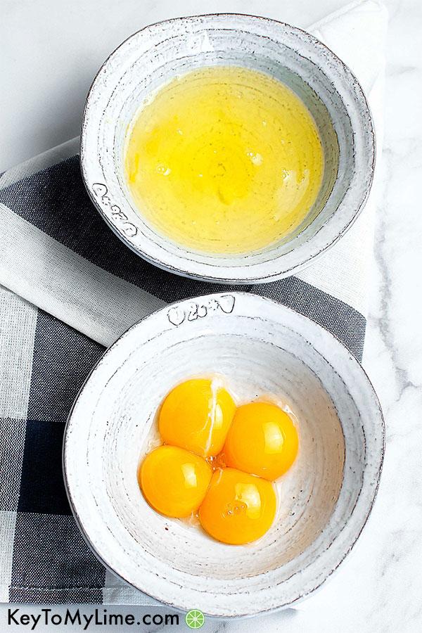 Bowls of egg whites and egg yolks.