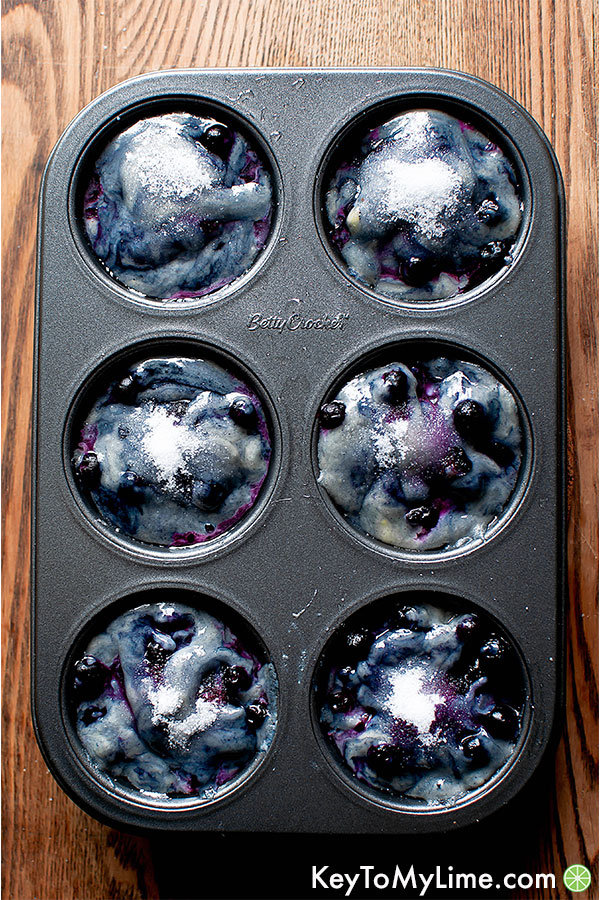 Dairy-free blueberry muffin batter in a muffin tin.