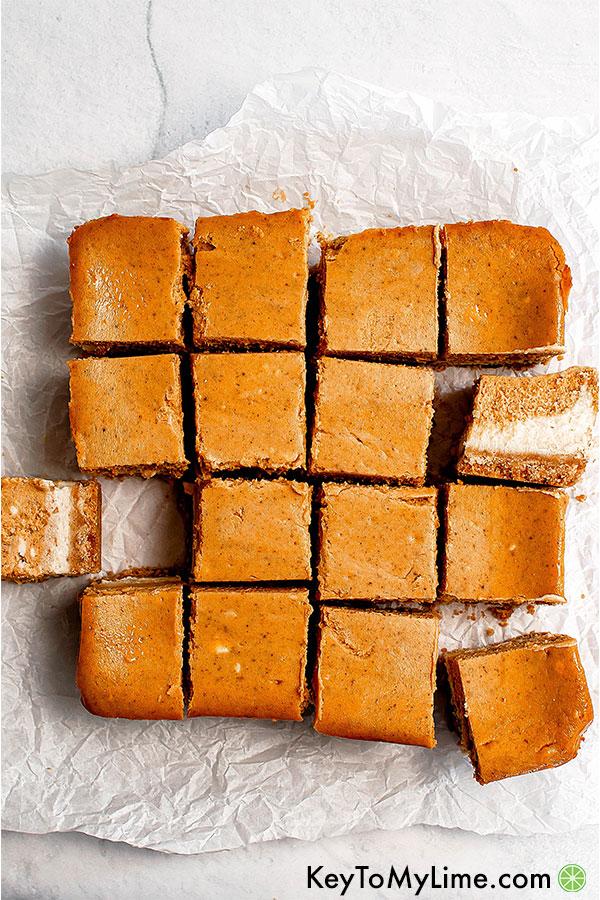 Pumpkin cheesecake cut into squares.