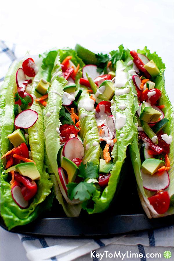 Raw vegan rainbow tacos with tahini lime dressing.
