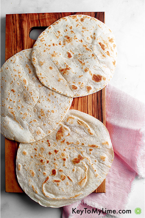 Tortillas with on a wooden board.