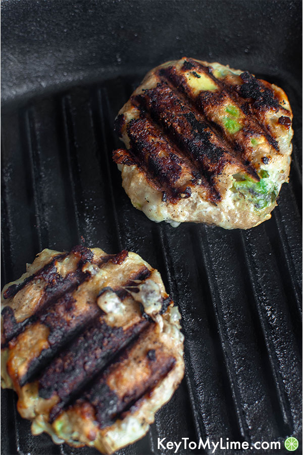 Turkey burgers on a grill pan.