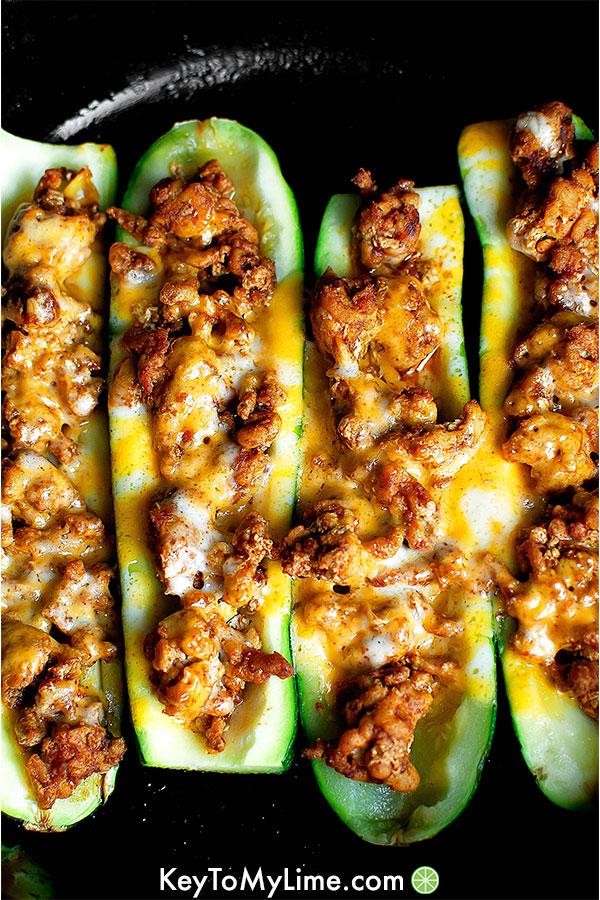 Turkey taco zucchini boats in a skillet.