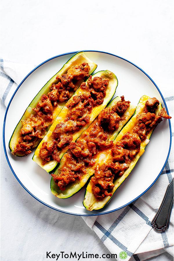 Turkey taco zucchini boats on a plate.