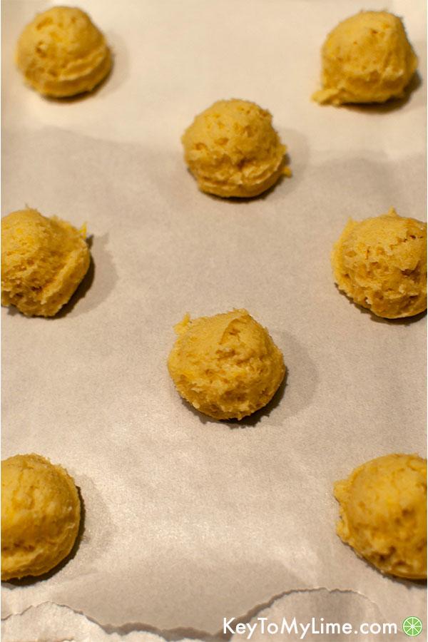 Lemon sugar cookie dough balls on baking sheet.