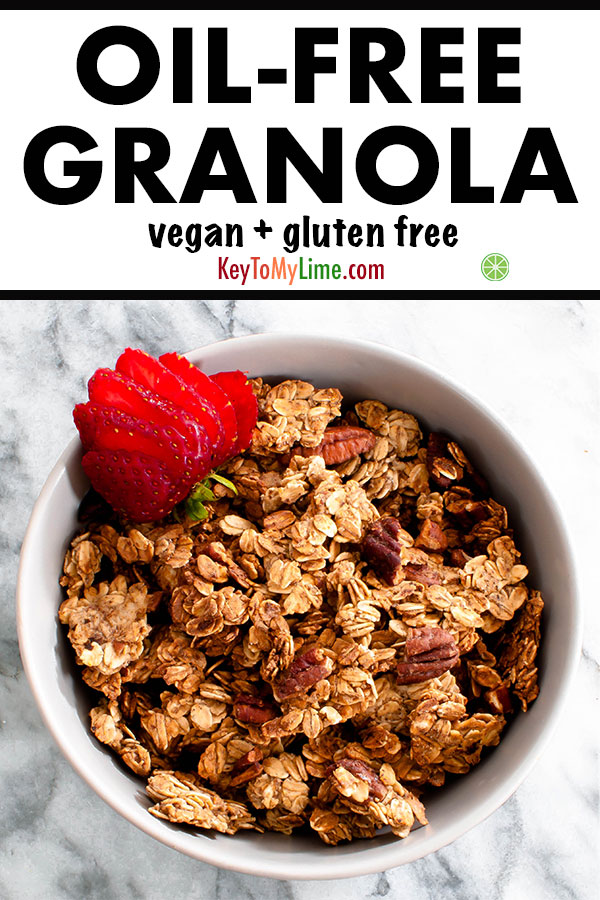 Vegan oil-free granola with sliced strawberry in a bowl.
