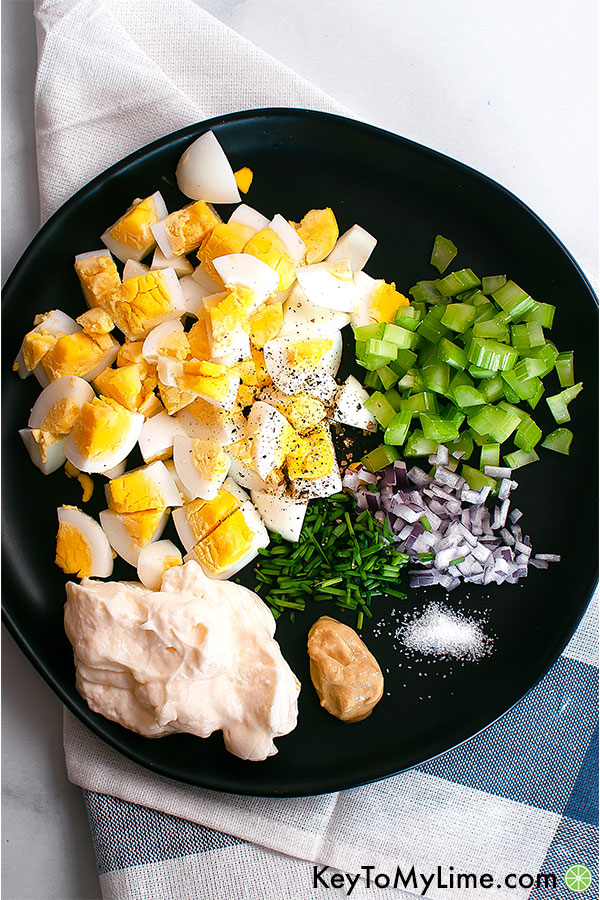 The ingredients for egg salad on a plate.