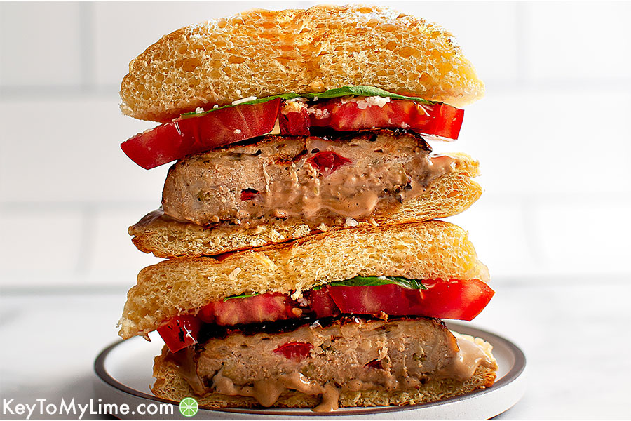 Two halves of a turkey bruschetta burger stacked on top of each other.