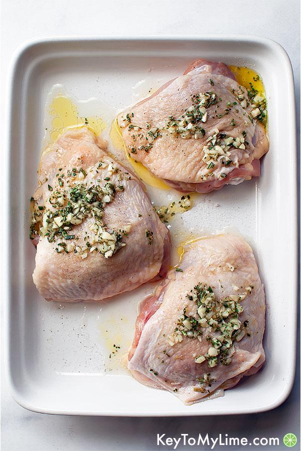Chicken thighs in lemon garlic rosemary marinade.