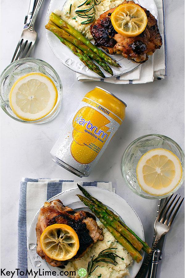 Two plates of lemon rosemary chicken.