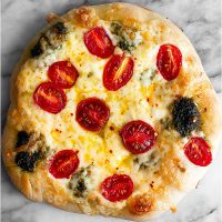 Pesto Pizza with Fresh Tomatoes and Mozzarella