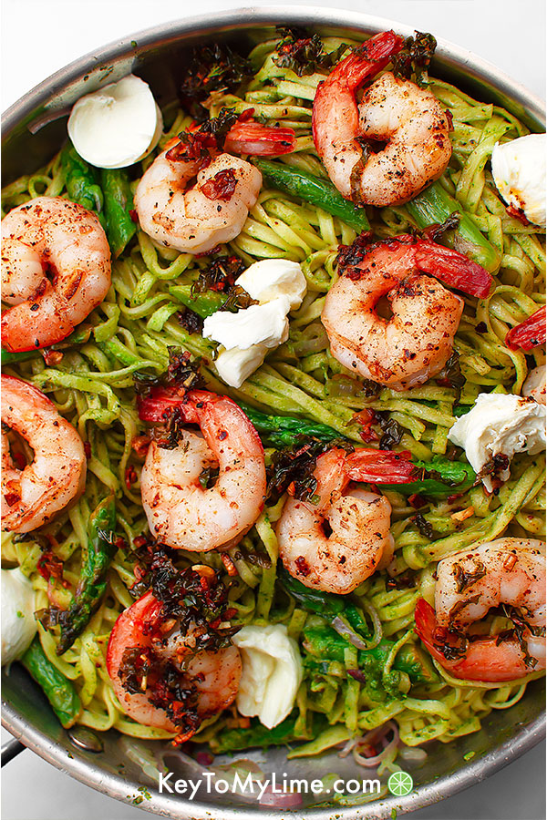 Shrimp pesto pasta in a skillet.